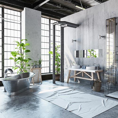Badzimmer im grauen Industriestyle mit freistehender Badewann